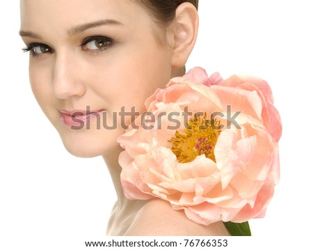 Young woman holding a big flower-close up - stock photo