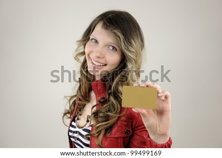 young woman holding a blank credit or gift card - stock photo
