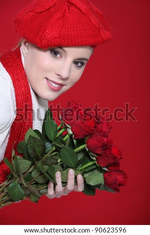 young woman holding a bouquet of roses - stock photo
