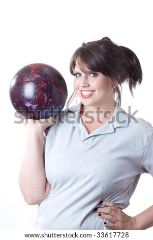 Young woman holding a bowling ball; isolated on a white background. - stock photo