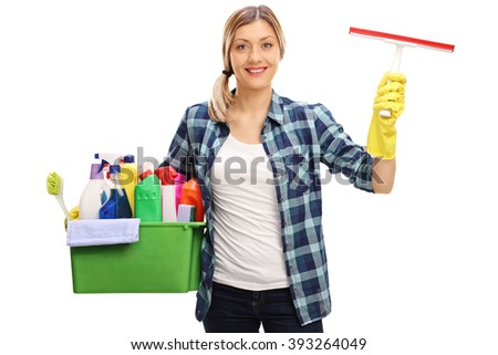 Young woman holding a bucket full of cleaning equipment and looking at the camera isolated on white background - stock photo