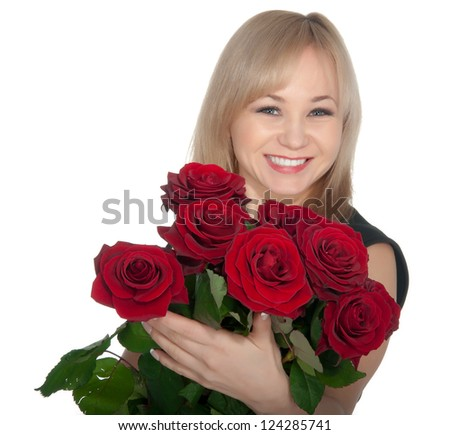Young woman holding a bunch of red roses - isolated on white background. - stock photo