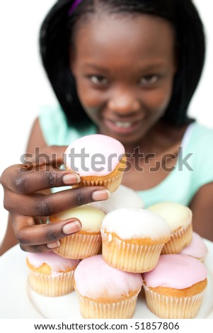 Young woman holding a cake against a white background - stock photo