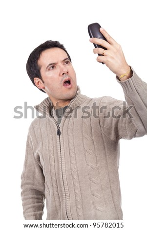 young woman holding a cellphone and looking surprised - stock photo