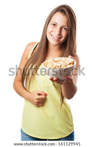 young woman holding a cereals bowl isolated on white - stock photo