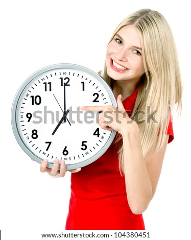 young woman holding a clock. time management concept. seven o`clock - stock photo