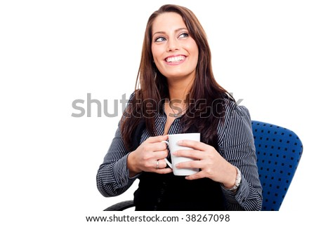 Young woman holding a cup of coffee in her hands
