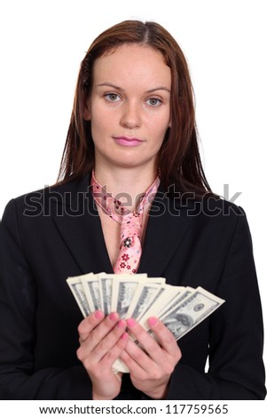 young woman holding a 100 dollar bill - stock photo
