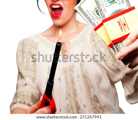 Young Woman holding a flame against money