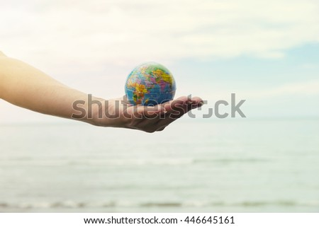 Young woman holding a globe in his hands, human hands with healthy world concept, love and safe conception. - stock photo