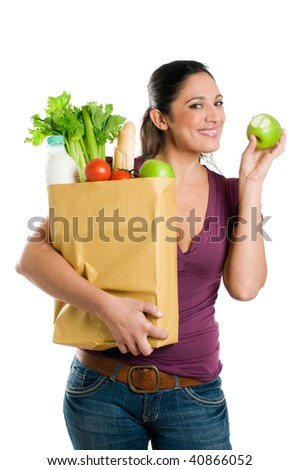 Young woman holding a grocery bag and eating a fresh apple isolated on white background