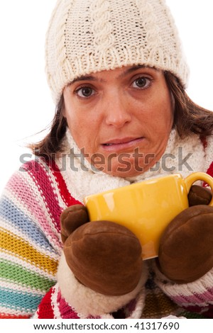 young woman holding a hot drink in a cold day - stock photo