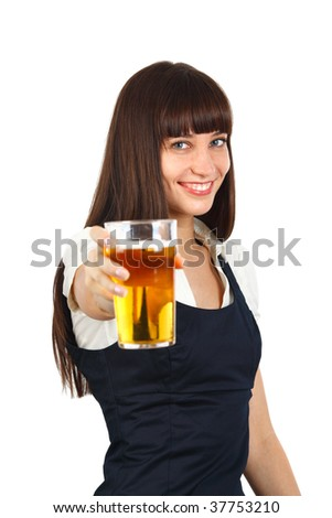young woman holding a pint of beer and toasting - stock photo