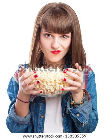 young woman holding a popcorn bowl on white - stock photo