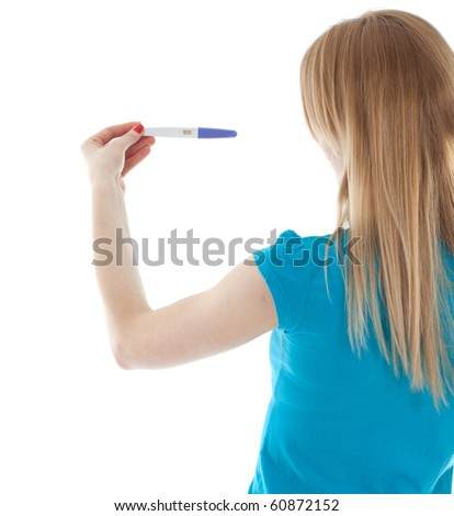 young woman holding a positive pregnancy test, focus selective on test - stock photo