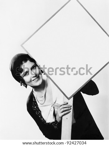 Young woman holding a sign - stock photo