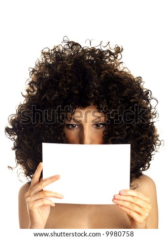 Young woman holding a sign. Portrait of beautiful woman reading blank board. Woman looking down at sign - stock photo