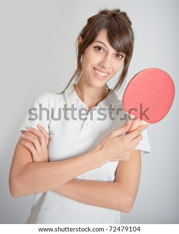 Young woman holding a table tennis racket - stock photo