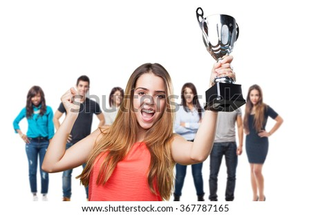 young woman holding a trophy on a white background - stock photo