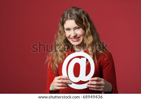 young woman holding an Internet icon - stock photo