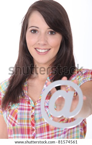 Young woman holding an sign - stock photo