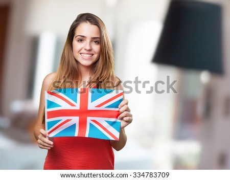 young woman holding an united kingdom flag on white