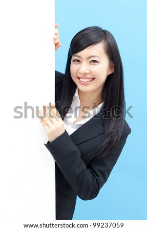 young woman holding blank billboard, isolated on blue background