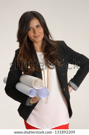 Young Woman Holding Blueprints.Architect And Interior Designer Young Woman  Portrait.