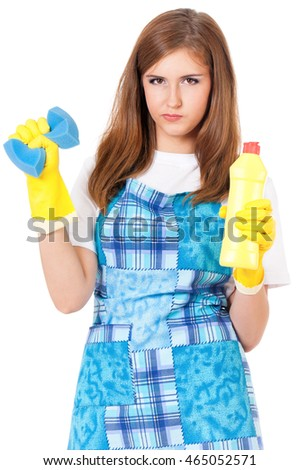Young woman holding bottle of chemistry for cleaning house. Cleaning concept. Beautiful girl with cleaning tools and products on white background. Housekeeper isolated portrait.