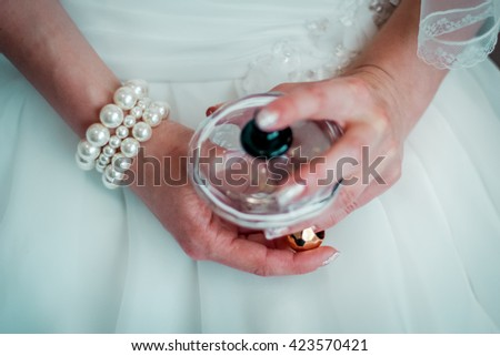 Young woman holding bottle perfume
