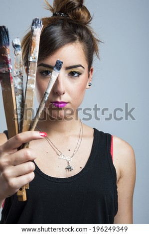 Young woman holding brush - stock photo