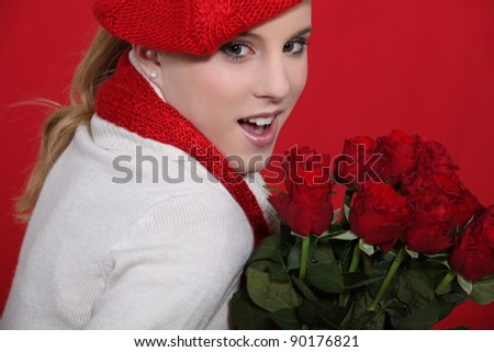 Young woman holding bunch of roses - stock photo