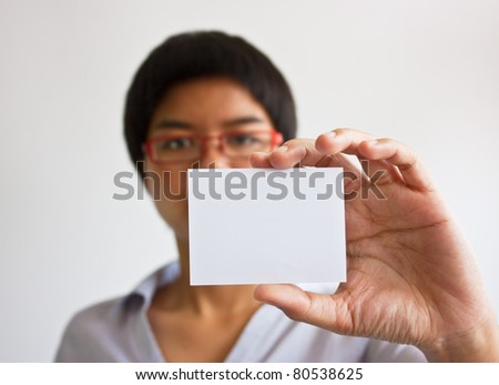young woman holding businesscard in hand. - stock photo