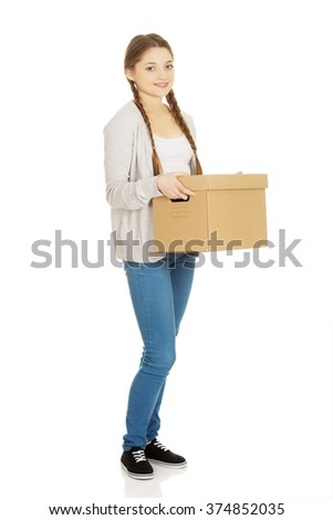 Young woman holding carton box.
