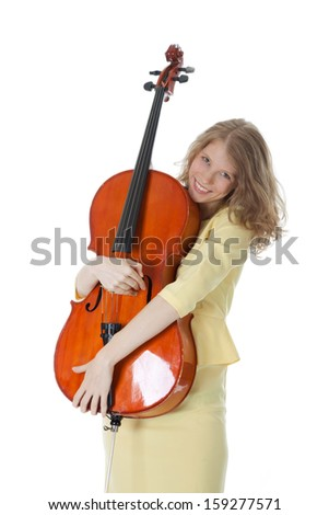 young woman holding cello in her arms and white background - stock photo
