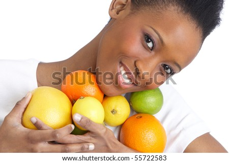 Young Woman Holding Citrus Fruit In Studio - stock photo