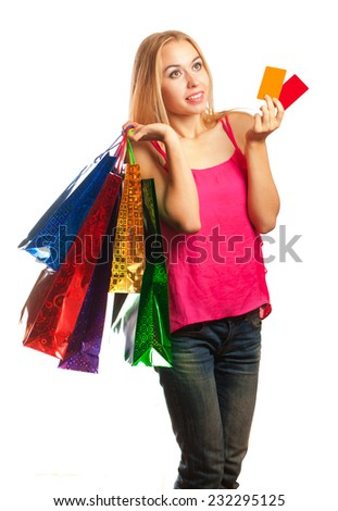 young woman holding colored bags and gift  cards isolated on white