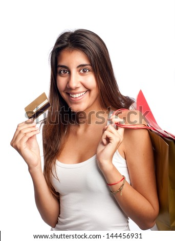 young woman holding credit card and bags isolated on white background - stock photo