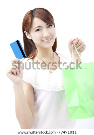 young woman holding credit card and shopping bag - stock photo