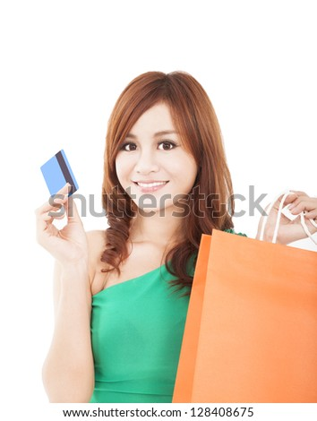 young woman holding credit card with shopping bag - stock photo