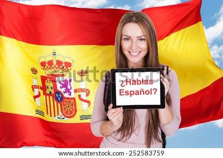 Young Woman Holding Digital Tablet Asking Do You Speak Spanish - stock photo
