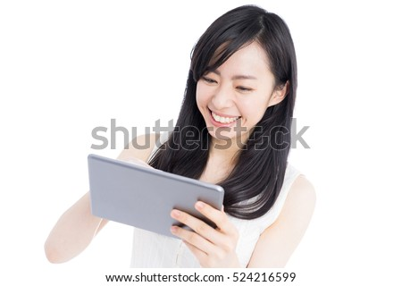 Young woman holding digital tablet, isolated on white background