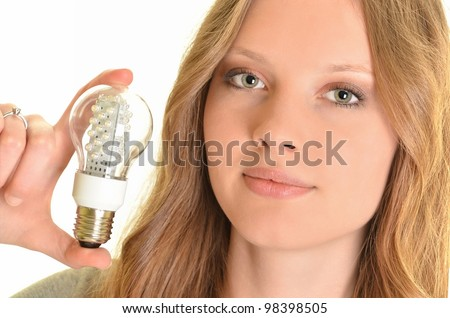 young woman holding diode bulb - stock photo