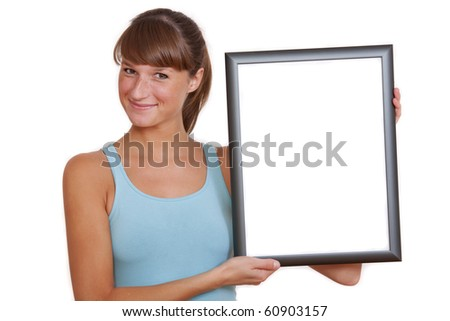 young woman holding empty frame on a white background - stock photo