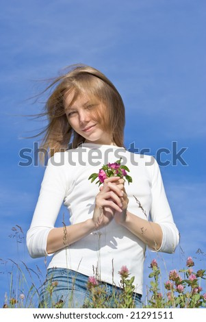 Young woman holding flower