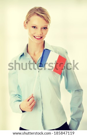 Young woman holding France flag - stock photo