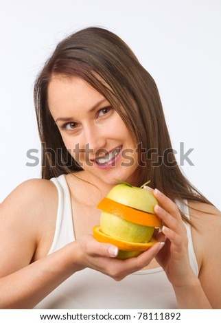 Young woman holding fresh fruit