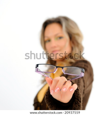 young woman holding glasses - stock photo