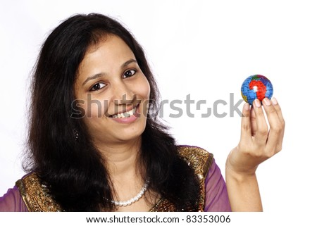 Young woman holding globe in the hands