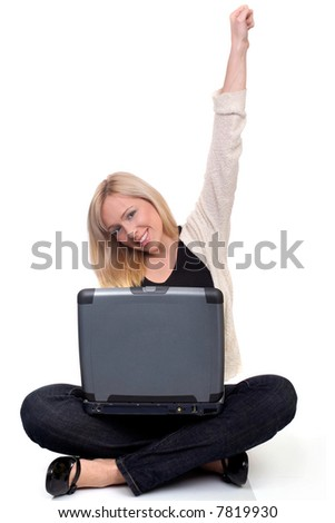 young woman holding hand up, indicating success in business or university - stock photo